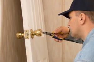 Locksmith installs lock