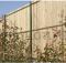 clôture occultante avec lattes en bois